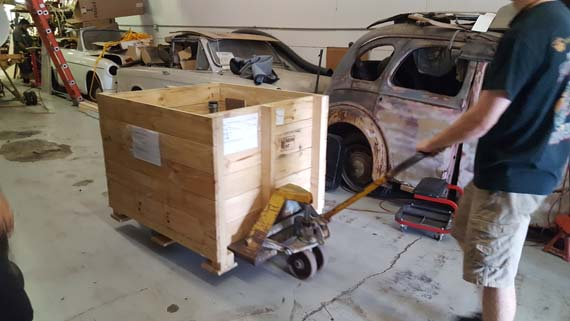 Gnome rotary engine crate being positioned for installation